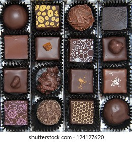 A box of various chocolate pralines - the photo is taken above