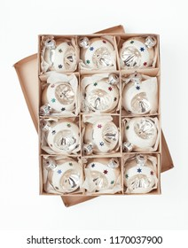 box with vintage Christmas baubles isolated over white background