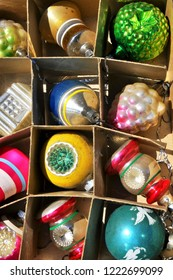 A box of vintage glass ornaments.