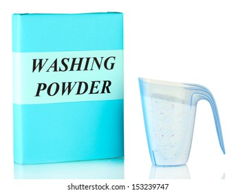Box of washing powder with blue measuring cup isolated on white