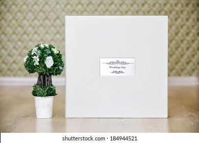 Box for wedding photo album with leather cover and metal shield, decorative tree.