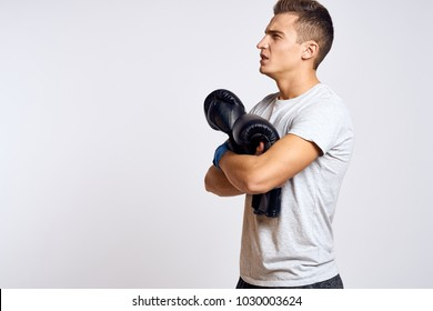 Boxer with boxing gloves on a light background