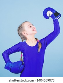 Boxer child in boxing gloves. Rise of women boxers. Female boxer change attitudes within sport. Free and confident. Girl cute boxer on blue background. With great power comes great responsibility.