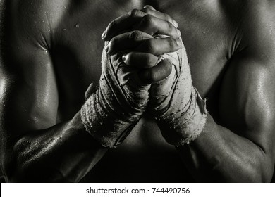 Boxer hand in monochrome photograph praying before the fight