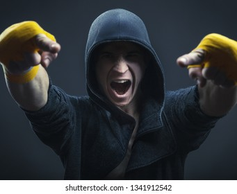 Boxer man in the hood is pointing fingers at you