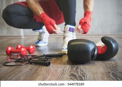 Boxer man preparing for training. Sport accessories.
