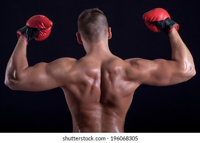 Boxer man  with red gloves showing his back