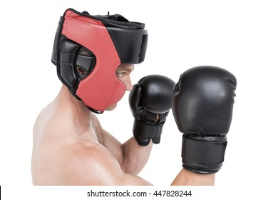 Boxer performing boxing stance on white background