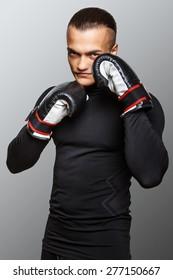 Boxer posing in studio on white background