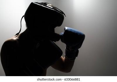 Boxer practicing shadows, studio photos