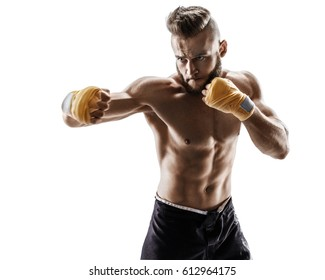 The boxer is ready to deal a powerful blow. Photo of muscular man isolated on white background. Strength and motivation.