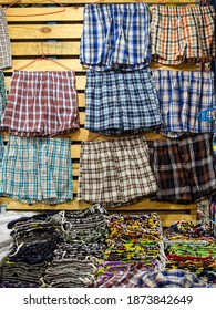 Boxer shorts of various colors and plaid patterns for sale at a tiangge, boutique or flea market. Cheap wholesale Men's underwear.