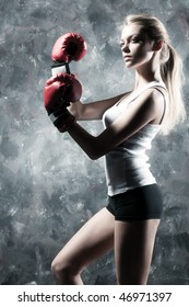 Boxer woman fashion. On wall background.