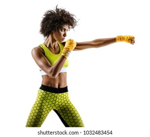 Boxer woman making direct hit. Photo of sporty african woman during boxing on white background. Dynamic movement. Side view