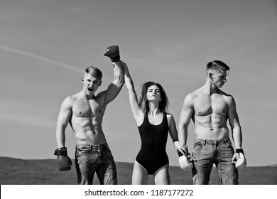 Boxer workout and healthy fitness. Men and coach sunny outdoor on blue sky. Winner and loser in boxing gloves with girl. Sport people or team work. Woman and happy twins with muscular body.