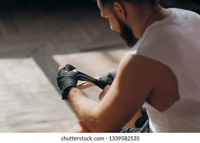 Boxer Wraps Hands. Man Boxer Wrapping Hands Getting Ready for a Fight