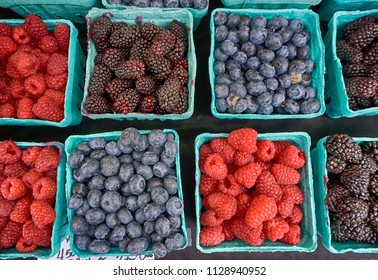 boxes of berries a a local farmer's market