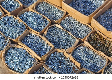 Boxes of Bolts and Nuts in Hardware Store