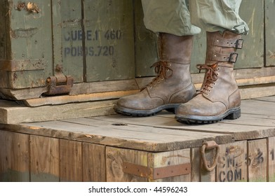 Boxes and boots of a soldier in a WW-II storage depot