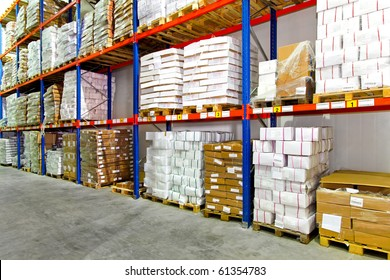 Boxes with frozen food at shelf in warehouse
