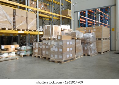 Boxes of Goods at Pallets in Distribution Warehouse