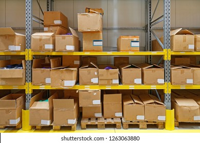 Boxes With Goods at Shelf in Storage Room Warehouse