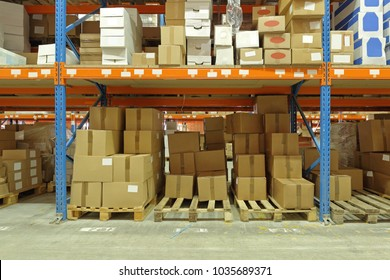 Boxes of Goods at Shelves in Distribution Warehouse