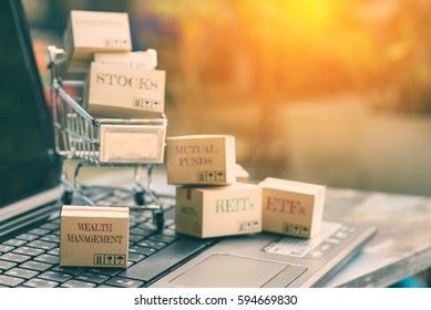Boxes of many types of financial investment products with the one labelled wealth management falls outside a shopping cart. Wealth management is important for everybody who rely on passive income.