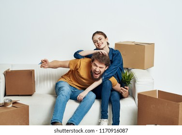 boxes moving couch young people