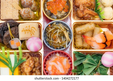 boxes with New Year dishes japanese food (osechi)