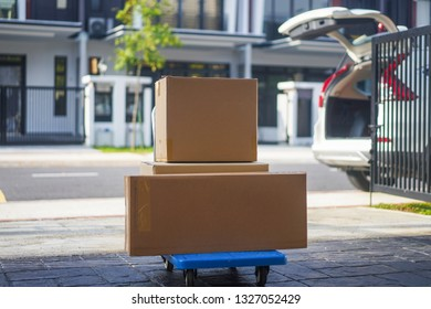 Boxes on trolley cart as delivery concept