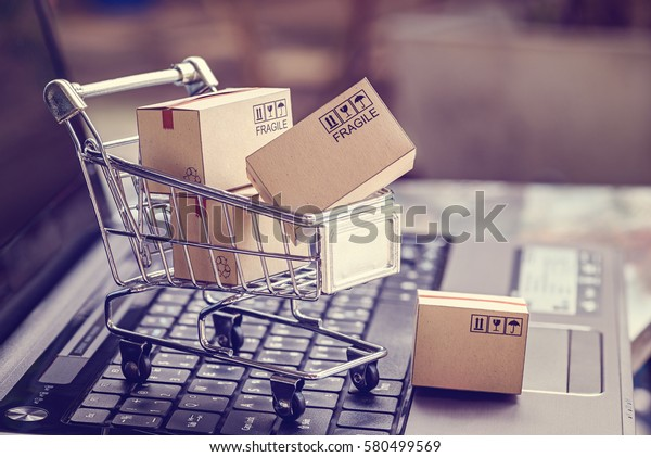 Boxes in a trolley on a laptop keyboard. Ideas about online shopping, online shopping is a form of electronic commerce that allows consumers to directly buy goods from a seller over the internet.