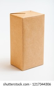 Boxes wrapped in kraft paper. Isolated on white.