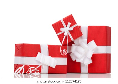 boxes with xmas presents wrapped in red paper isolated on white - Xmas Presents