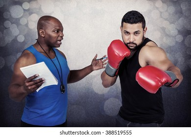 Boxing coach with his fighter against grey