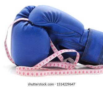 Boxing glove and centimeter tape isolated on a white background.