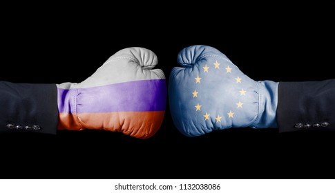 Boxing gloves with European Union and Russian flag. European Union versus Russia concept on black