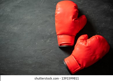 Boxing Gloves on black cement background. Concept of fighting or boxing. Top view and copy space for text.