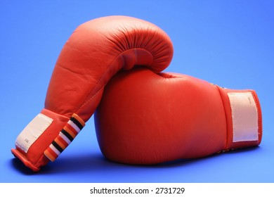 Boxing gloves on blue background