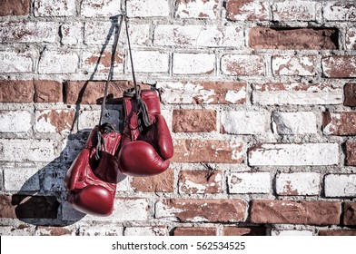 boxing gloves on the brick wall. Vintage image