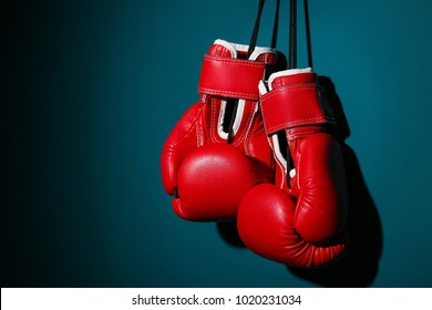 Boxing gloves on color background
