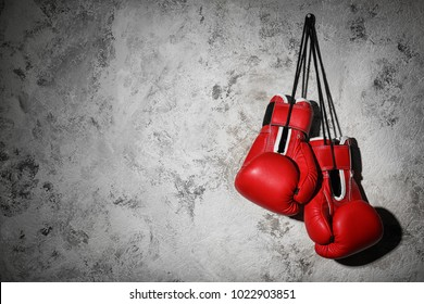 Boxing gloves on gray background