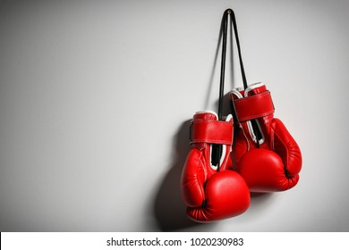 Boxing gloves on light background