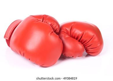 Boxing gloves over white.