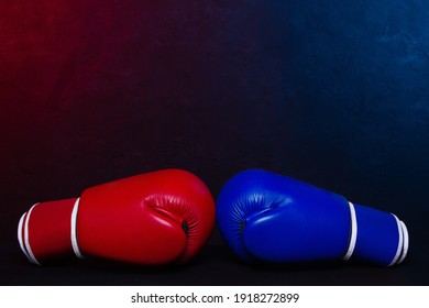 Boxing gloves Red and Blue hitting together poster design.
