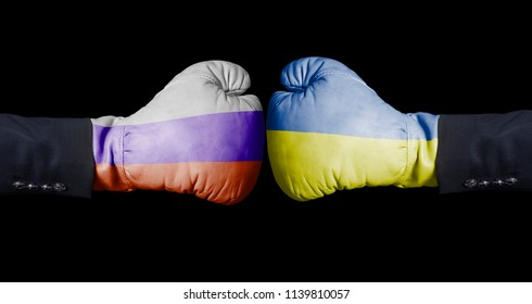 Boxing gloves with Russian and Ukrainian flag. Russia versus Ukraine concept on black