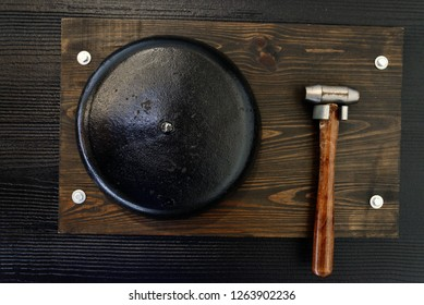 boxing hammer and gong on a wooden board