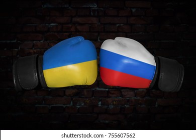 boxing match. Confrontation between the Ukraine and Russia. Russian and Ukrainian national flags on Boxing gloves. Sports competition between the two countries. Concept of the foreign policy conflict.