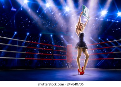 Boxing ring girl  is holding the number 4