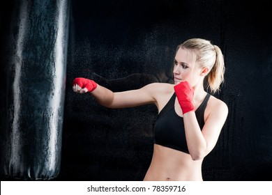 Boxing training woman sparring punching bag in gym wear gloves